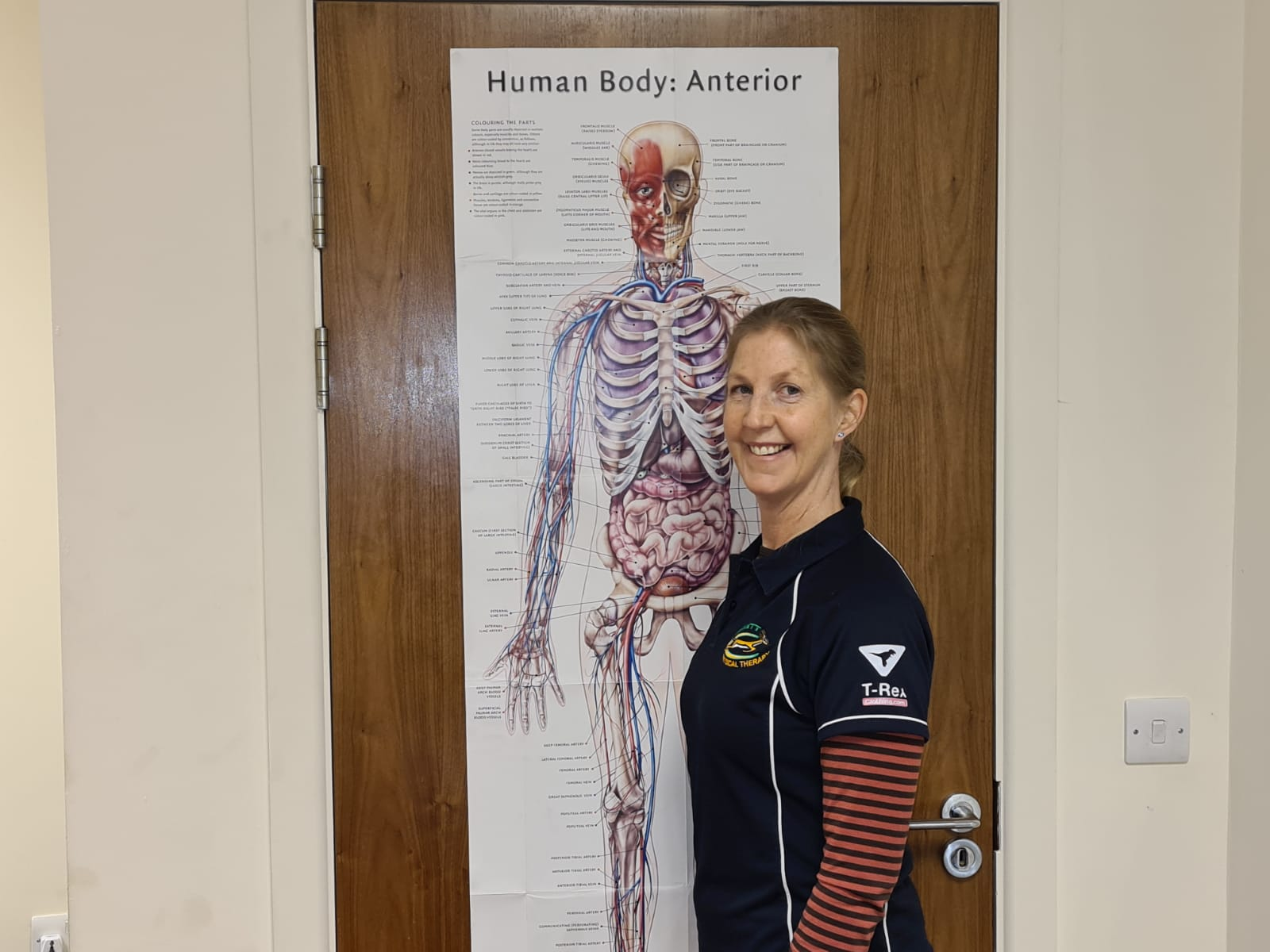 Hartnett Physical Therapy Angie with a Skelton of the human body